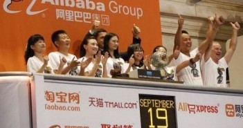 "Alibaba representatives applaud as the opening bell of the New York Stock Exchange is rung, before the initial public offering (IPO) of Alibaba Group Holding Ltd under the ticker ""BABA"" in New York"
